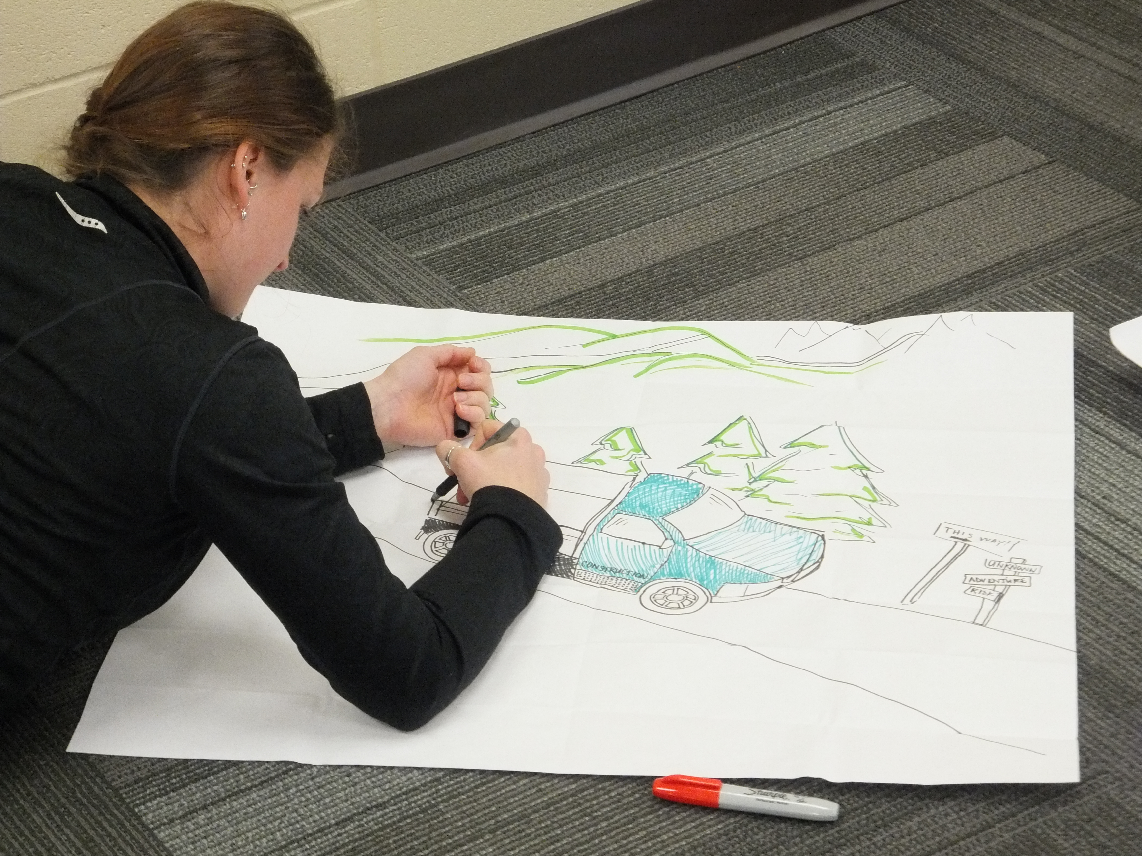 A woman drawing a map.