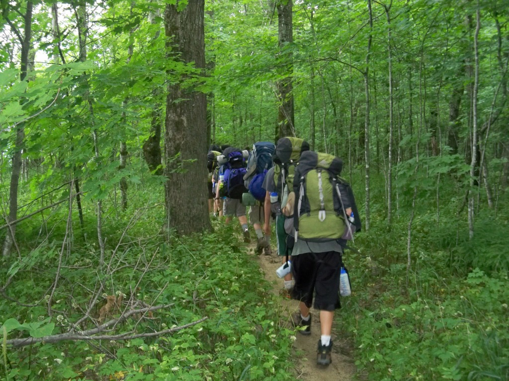 A group of hikers head out down the trail.