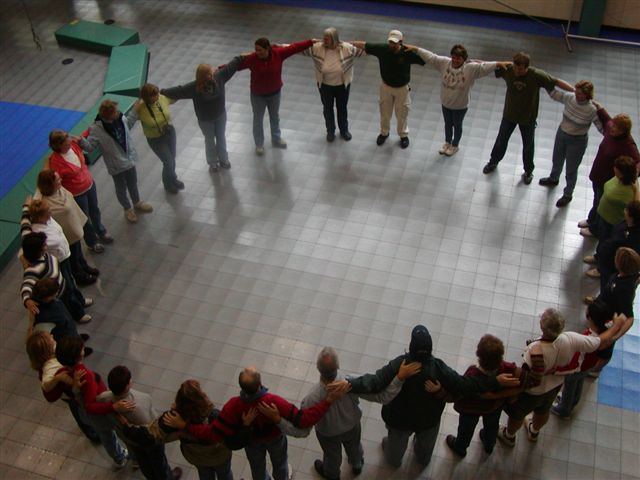 A group of participants standing in a circle.